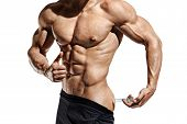 Bodybuilder Makes An Injection Of Vitamins. Photo Of Sporty Man With Perfect Physique Showing Gestur poster