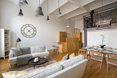 Multifunctional Home Interior With Stylish Ceiling Beams And Mezzanine poster