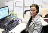 stock photo of telephone operator  - Beautiful female call center operator headset customer service in a real situation not everyday isolation image - JPG