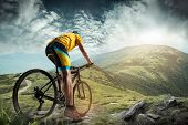 The Young Fit Man In Helmet Conquering Mountains On A Bicycle. The Bike, Nature, Bicycle, Sport, Cyc poster