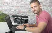 A Video Editor With Laptop Computer And Professional Video Camera poster