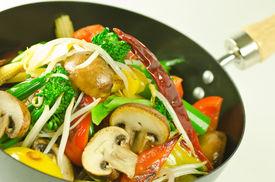 stock photo of stir fry  - colorful mushroom and vegetable stir fry in a wok  - JPG