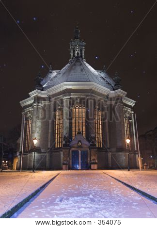 The New Church In The Hague / Nieuwe Kerk Den Haag Covered In Snow At Night, While Snowing.