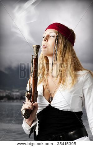 Girl Pirate Blows A Smoke From A Old Pistol