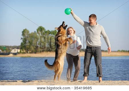 Pregnant woman and man with dog