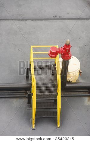 Red Valve Over Yellow And Black Steps