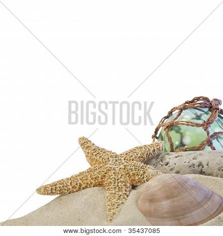 Seashells On Sand With Glass Ball On White