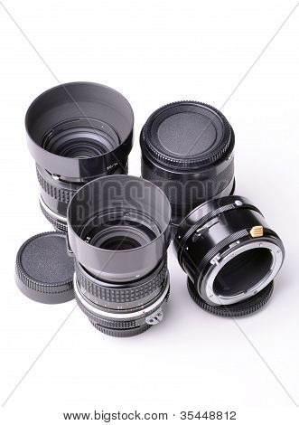 collection of photographic lenses, on a white background