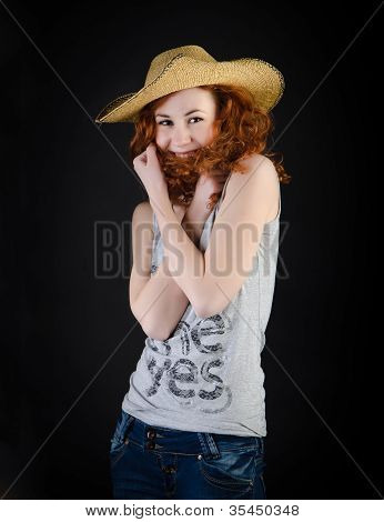 Red-haired Girl In A Straw Hat