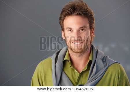 Closeup portrait of smiling goodlooking man, copyspace.