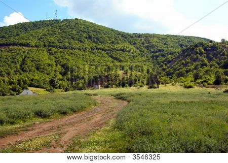 Serene Mountain Rural Landscape With Dirt Road