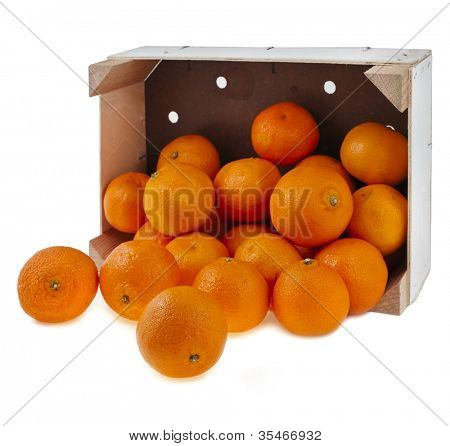 ripe orange mandarines in wooden box isolated on white