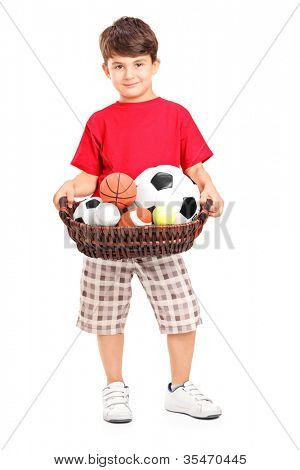 Boy holding a basket with balls, isolated on white background