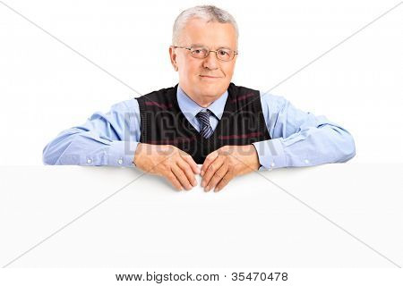 Mature man posing behing white panel, isolated on white background