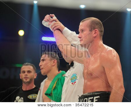 ODESSA, UKRAINE - JULY 21: Vyacheslav Uzelkov wins the match with Mohamed Belkacem for WBO Inter-Continental light heavyweight title in Odessa, Ukraine at July 21, 2012