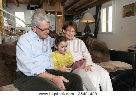 Old couple sat with their granddaughter