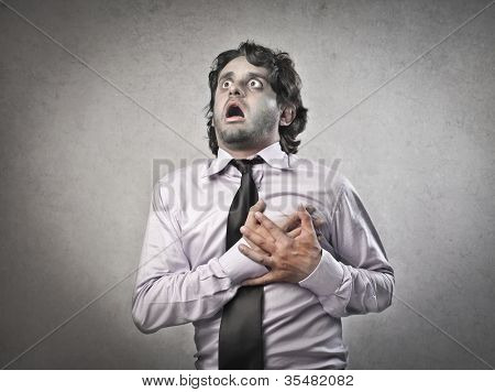 Businessman with painful expression having a heart attack