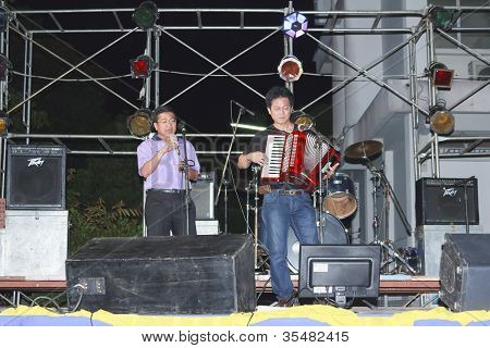 Men Singing And Playing Accordion