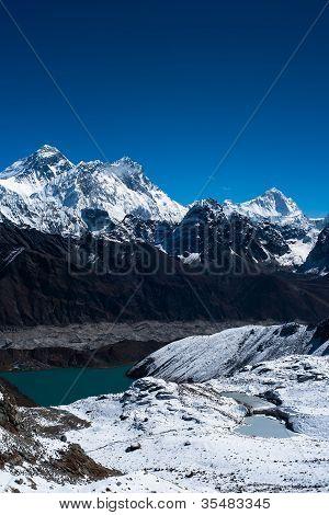 Everest, Nuptse, Lhotse And Makalu Peaks. Gokyo Lake And Village