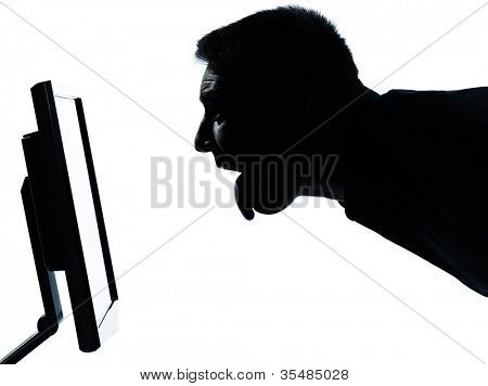 one caucasian business man face tongue out silhouette with computer screen display portrait in studio isolated on white background