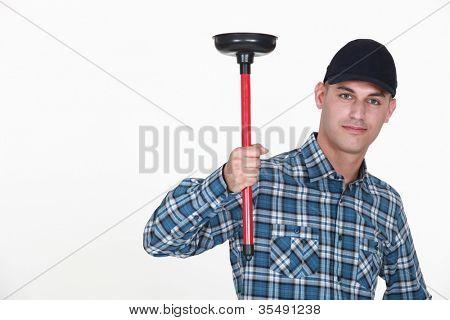 Plumber holding plunger