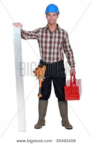 Manual worker stood with tool-box