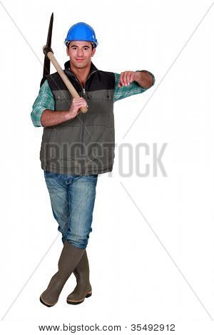 Construction working carrying a pickaxe and leaning against an invisible object