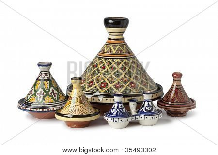 Traditional Moroccan tagines on white background