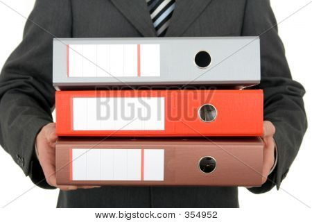 Businessman Holding Binders