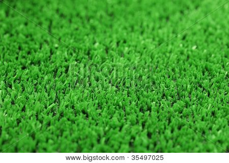 backgrounnd of artificial green grass