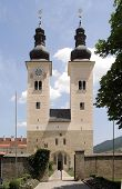 stock photo of glans  - frontal shot of Cloister Gurk with two steeples in Austria in sunny ambiance - JPG