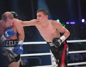 ODESSA, UKRAINE - JULY 21: Vyacheslav Uzelkov (left) vs Mohamed Belkacem in fight for WBO Inter-Cont