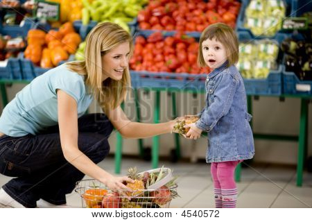 Mother And Daughter In Supermarket