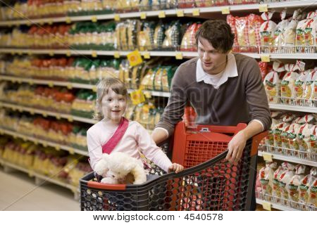 Father And Daughter At Supermarket