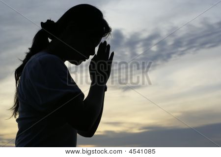 Silhouette Of A Woman Praying