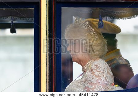 LONDON - UK, MAY 08: London, UK. May 8th, 2013. Prince Charles and Camilla, Duchess of Cornwall leaving Buckingham Palace and going to the State Opening of Parliament on May 8, 2013 in London.