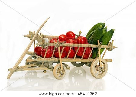 Old handcart full of tomatoes and cucumbers