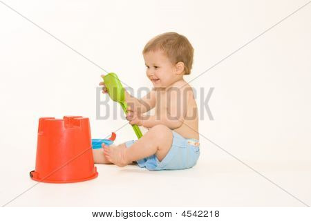 Joyful Baby Playing With Beach Toys