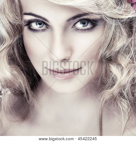 Closeup portrait of sexy whiteheaded young woman with beautiful blue eyes on light - grey  background