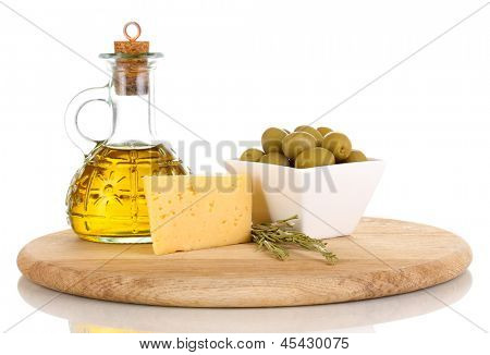 Green olives in white bowl with rosemary,olive oil and cheese on board isolated on white