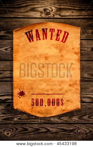 Vintage wanted poster with curled edge against the background of an aged wood