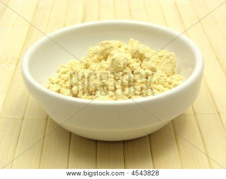 Soy Meal In A Little White Bowl Of Chinaware On A Placemat