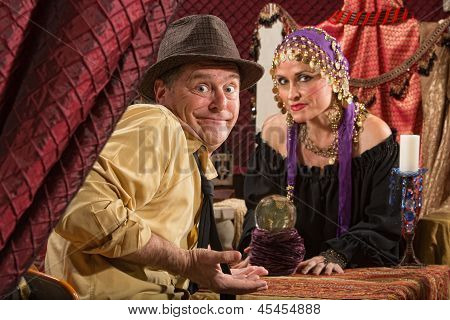 Fortune Teller And Skeptical Man
