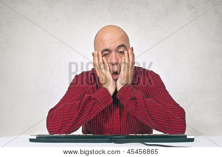 Worried Man At Office Table