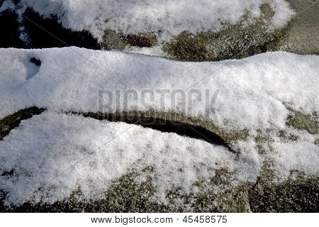 Snow lies on the stones of a dolmen in Netherlands
