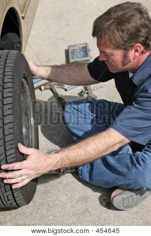 Mechanic Removing Tire
