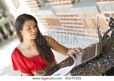 Studying Female Student On A Laptop