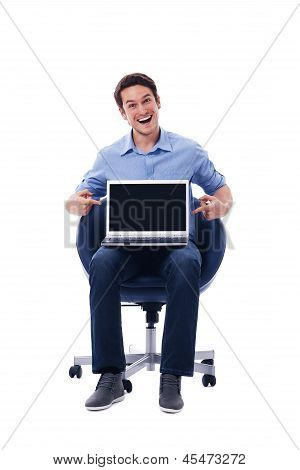 Surprised man pointing on laptop