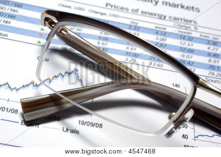 Glass Of Eyewear And Financial Report Macro.