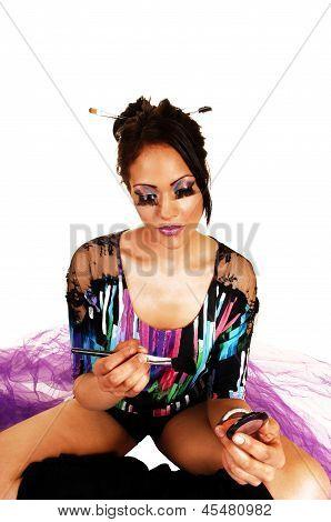 Girl Putting On Makeup.